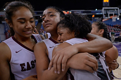 Eastside College Prep Mina Tameilau (4) watches as Kayla Tahaafe (5) hugs teammate Alayah Bell (13) as they celebrate their win against Village Christian during their CIF Division V state championship girls basketball game at Sleep Train Arena in Sacramento, Calif., on Thursday, March 24, 2016. Eastside College Prep defeated Village Christian 57-50. (Jose Carlos Fajardo/Bay Area News Group)