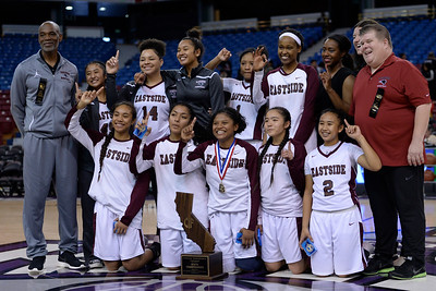 Eastside College Prep pose for a group photo with their first place trophy after defeating Village Christian during their CIF Division V state championship girls basketball game at Sleep Train Arena in Sacramento, Calif., on Thursday, March 24, 2016. Eastside College Prep defeated Village Christian 57-50. (Jose Carlos Fajardo/Bay Area News Group)