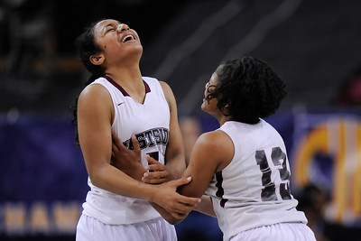 Eastside College Prep's Kayla Tahaafe (5) celebrates with teammate Alayah Bell after defeating Village Christian during their CIF Division V state championship girls basketball game at Sleep Train Arena in Sacramento, Calif., on Thursday, March 24, 2016. Eastside College Prep defeated Village Christian 57-50. (Jose Carlos Fajardo/Bay Area News Group)