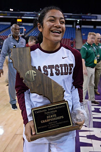 Eastside College Prep's Kayla Tahaafe (5) smiles as she walks off the court holding the first place trophy after defeating Village Christian during their CIF Division V state championship girls basketball game at Sleep Train Arena in Sacramento, Calif., on Thursday, March 24, 2016. Eastside College Prep defeated Village Christian 57-50. (Jose Carlos Fajardo/Bay Area News Group)