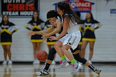 Bishop O'Dowd's Jada Holland (4), left, battles Miramonte's Keana Delos Santos (11) for a loose ball during the second period of their North Coast Section Division 3 girls basketball championship game at McKeon Pavilion in Moraga, Calif., on Saturday, March 5, 2016. (Jose Carlos Fajardo/Bay Area News Group)