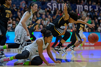 Miramonte's Jordyn Bryant (33) falls to the ground while battling for a loose ball with Bishop O'Dowd's Salihah Bey (3) during the third period of their North Coast Section Division 3 girls basketball championship game at McKeon Pavilion in Moraga, Calif., on Saturday, March 5, 2016. (Jose Carlos Fajardo/Bay Area News Group)