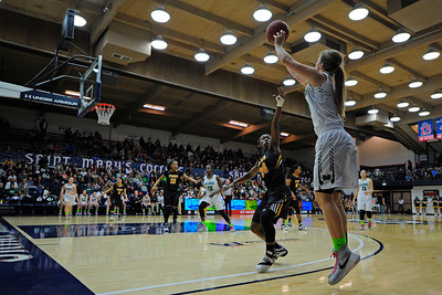 Miramonte's Sabrina Ionescu (20) attempts to shoot a three-point basket over Bishop O'Dowd's Alexa Mason (24) during the third period of their North Coast Section Division 3 girls basketball championship game at McKeon Pavilion in Moraga, Calif., on Saturday, March 5, 2016. (Jose Carlos Fajardo/Bay Area News Group)