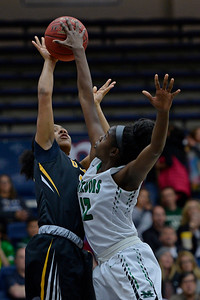 Bishop O'Dowd's Zakiya Mahoney (15) gets her shot blocked by Miramonte's Uriah Howard (12) during the first period of their North Coast Section Division 3 girls basketball championship game at McKeon Pavilion in Moraga, Calif., on Saturday, March 5, 2016. (Jose Carlos Fajardo/Bay Area News Group)