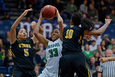Miramonte's Jordyn Bryant (33) grabs a rebound in front of Bishop O'Dowd's Mylah Andrada (5) and Bishop O'Dowd's Myah Pace (10) during the third period of their North Coast Section Division 3 girls basketball championship game at McKeon Pavilion in Moraga, Calif., on Saturday, March 5, 2016. (Jose Carlos Fajardo/Bay Area News Group)