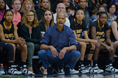 Bishop O'Dowd head coach Malik McCord coaches from the bench while playing Miramonte during the second period of their North Coast Section Division 3 girls basketball championship game at McKeon Pavilion in Moraga, Calif., on Saturday, March 5, 2016. (Jose Carlos Fajardo/Bay Area News Group)