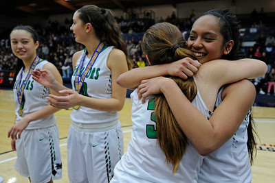 Miramonte's Clair Steele (3), left, hugs her teammate Keana Delos Santos (11) after receiving their first place medals during their North Coast Section Division 3 girls basketball championship game at McKeon Pavilion in Moraga, Calif., on Saturday, March 5, 2016. (Jose Carlos Fajardo/Bay Area News Group)