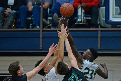 Moreau Catholic's Oscar Frayer (21) reaches for a rebound against Miramonte's Enzo Jiannatone (32) during the first period of their North Coast Section Division 3 boys basketball championship game at McKeon Pavilion in Moraga, Calif., on Saturday, March 5, 2016. (Jose Carlos Fajardo/Bay Area News Group)