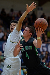 Moreau Catholic's Jordan White (25) attempts to block Miramonte's Eddy Ionescu (4) during the second period of their North Coast Section Division 3 boys basketball championship game at McKeon Pavilion in Moraga, Calif., on Saturday, March 5, 2016. (Jose Carlos Fajardo/Bay Area News Group)