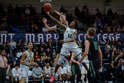 Moreau Catholic's Terrell Brown (12) goes up for a lay up past Miramonte's Enzo Jiannatone (32) during the fourth period of their North Coast Section Division 3 boys basketball championship game at McKeon Pavilion in Moraga, Calif., on Saturday, March 5, 2016. (Jose Carlos Fajardo/Bay Area News Group)