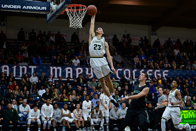 Moreau Catholic's Brandon Lawrence (23) goes up for a lay up past Miramonte's Eddy Ionescu (4) during the fourth period of their North Coast Section Division 3 boys basketball championship game at McKeon Pavilion in Moraga, Calif., on Saturday, March 5, 2016. (Jose Carlos Fajardo/Bay Area News Group)