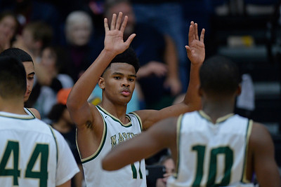Moreau Catholic's Damari Milstead (11) gestures to his teammate Moreau Catholic's LJ Anderson (10) as they celebrate their win against Miramonte during the North Coast Section Division 3 boys basketball championship game at McKeon Pavilion in Moraga, Calif., on Saturday, March 5, 2016. (Jose Carlos Fajardo/Bay Area News Group)