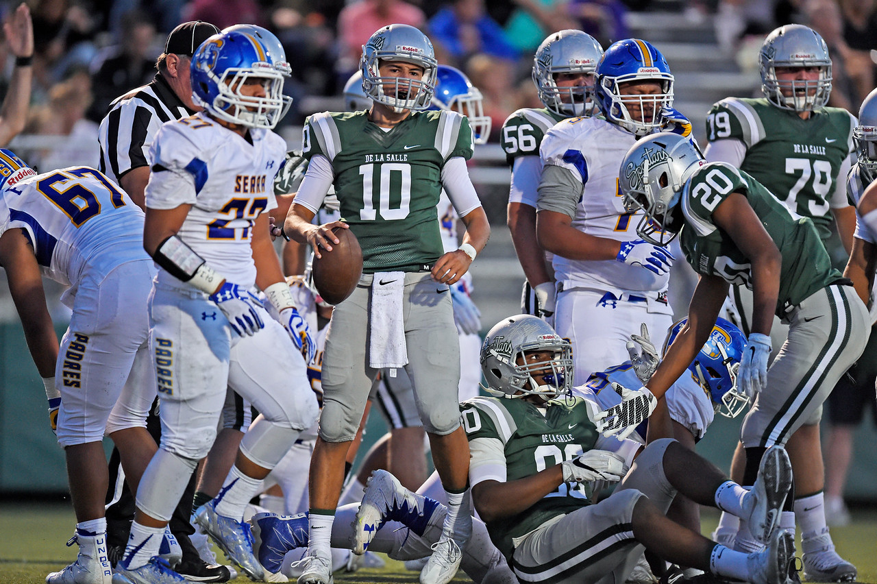 De La Salle quarterback Abel Ordaz (10) emerges after running into the end zone for a touchdown against Serra in the first quarter of their game at De La Salle High School in Concord, Calif., on Friday, Sept. 2, 2016. (Jose Carlos Fajardo/Bay Area News Group)