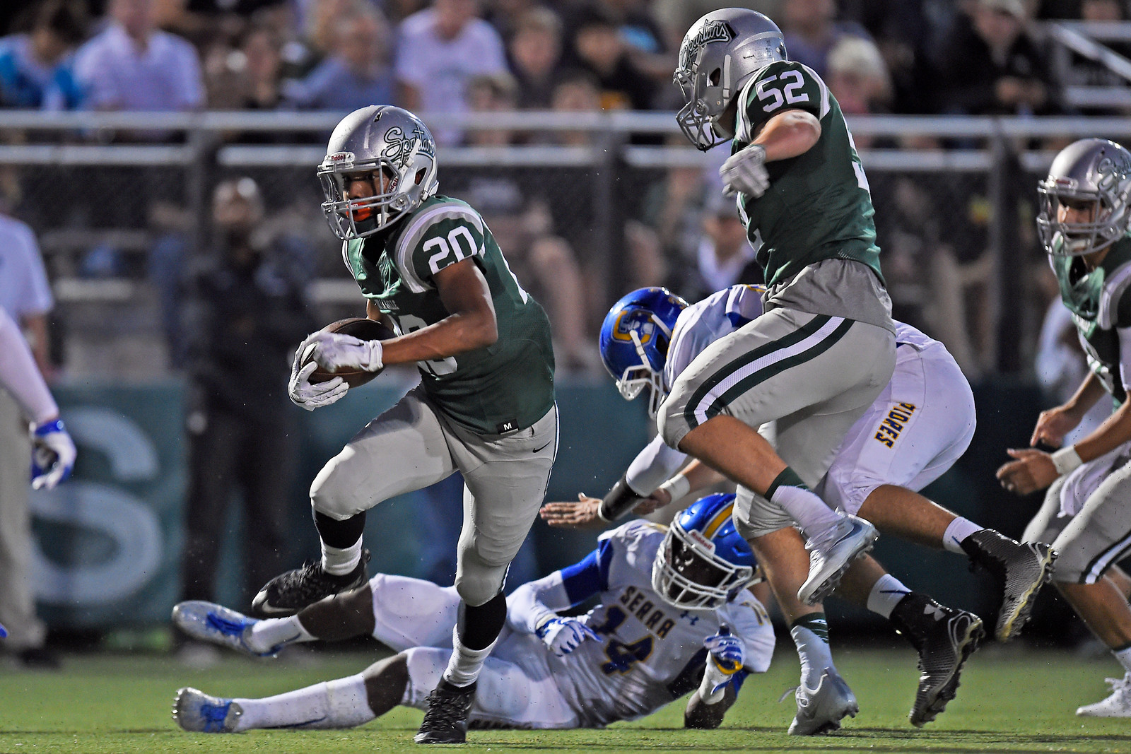 De La Salle's Tre White (20) runs with the ball against Serra in the first quarter of their game at De La Salle High School in Concord, Calif., on Friday, Sept. 2, 2016. (Jose Carlos Fajardo/Bay Area News Group)