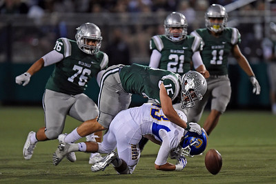 De La Salle's Luke Freeman (15) hits Serra's Zavier King (43) while attempting to pick up the ball during a kickoff return in the second quarter of their game at De La Salle High School in Concord, Calif., on Friday, Sept. 2, 2016. (Jose Carlos Fajardo/Bay Area News Group)