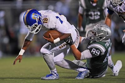 De La Salle's Anthony Friedman (89) sacks Serra quarterback Leki Nunn (16) in the first quarter of their game at De La Salle High School in Concord, Calif., on Friday, Sept. 2, 2016. (Jose Carlos Fajardo/Bay Area News Group)