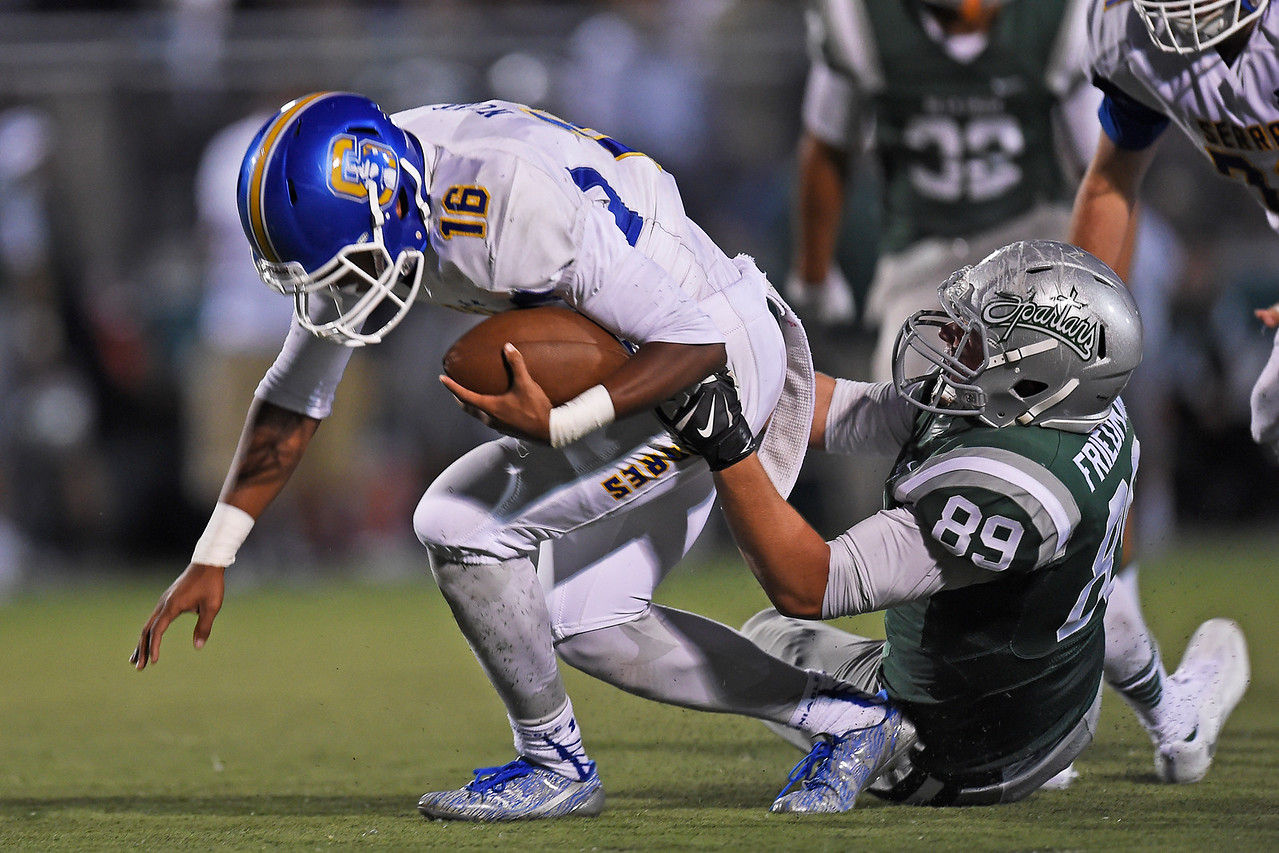 De La Salle's Anthony Friedman (89) sacks Serra quarterback Leki Nunn (16) in the first quarter of their game at De La Salle High School in Concord, Calif., on Friday, Sept. 2, 2016. (Jose Carlos Fajardo/Bay Area News Group)