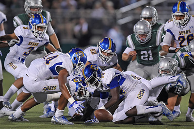 Serra's Taniela Latu (44) and Serra's Jovon Johnson (14) watch as the ball rolls out of their grasp during a kickoff return against De La Salle in the second quarter of their game at De La Salle High School in Concord, Calif., on Friday, Sept. 2, 2016. (Jose Carlos Fajardo/Bay Area News Group)