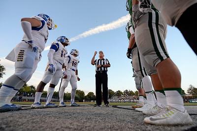A referee tosses a coin at the start of the De La Salle vs. Serra game at De La Salle High School in Concord, Calif., on Friday, Sept. 2, 2016. (Jose Carlos Fajardo/Bay Area News Group)