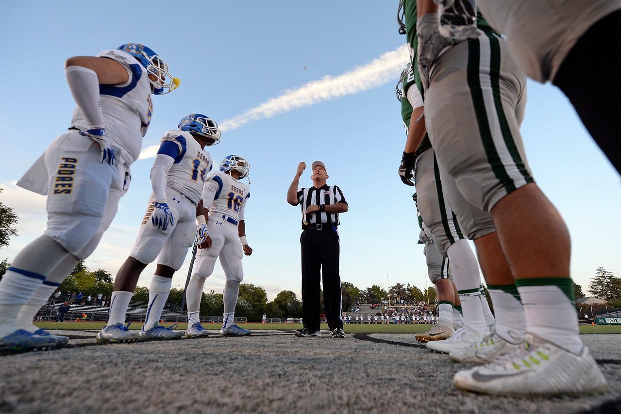 A referee tosses a coin at the start of the De La Salle vs. Serra game at De La Salle High School in Concord, Calif., on Friday, Sept. 2, 2016. (Jose Carlos Fajardo/Bay Area News Group)