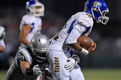 De La Salle's Brenden Riso (29) tackles Serra quarterback Leki Nunn (16) in the second quarter of their game at De La Salle High School in Concord, Calif., on Friday, Sept. 2, 2016. (Jose Carlos Fajardo/Bay Area News Group)