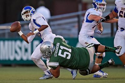 De La Salle's Tuli Letuligasenoa (51) sacks Serra quarterback Leki Nunn (16) in the first quarter of their game at De La Salle High School in Concord, Calif., on Friday, Sept. 2, 2016. (Jose Carlos Fajardo/Bay Area News Group)