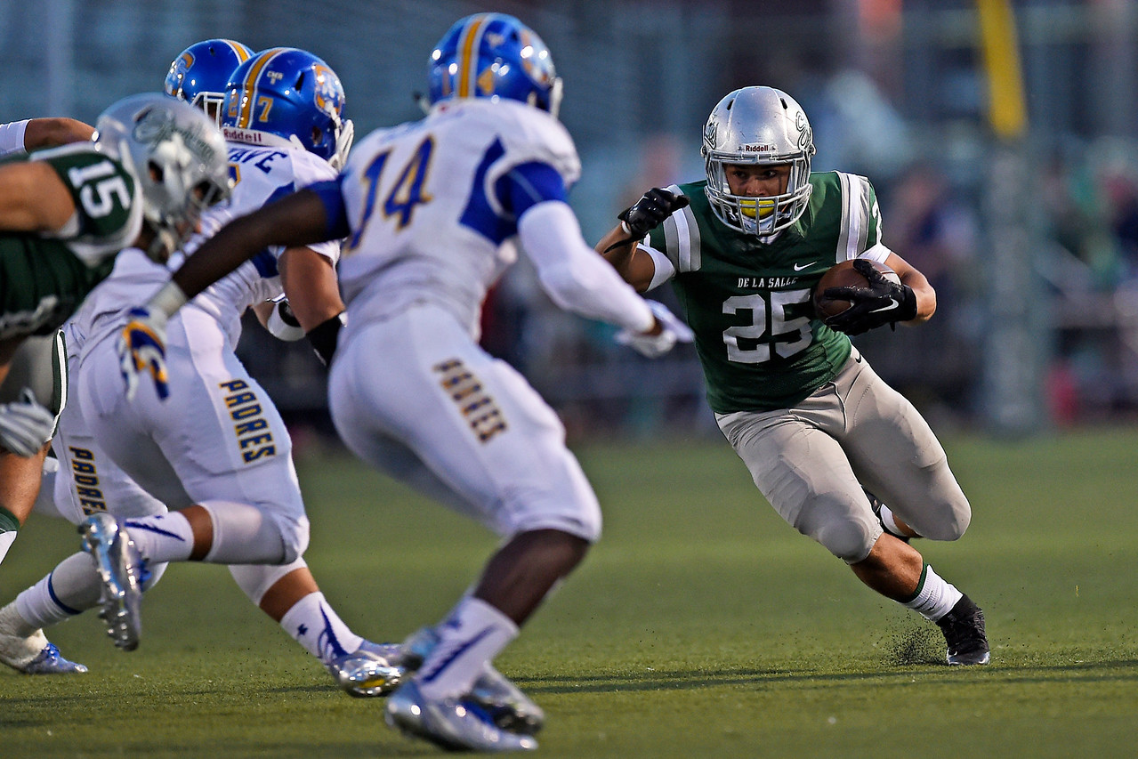 De La Salle's Kairee Robinson (25) runs with the ball against Serra in the first quarter of their game at De La Salle High School in Concord, Calif., on Friday, Sept. 2, 2016. (Jose Carlos Fajardo/Bay Area News Group)