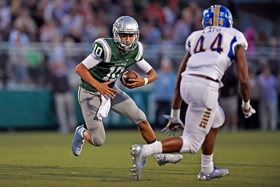 De La Salle quarterback Abel Ordaz (10) runs with the ball while being guarded by Serra's Taniela Latu (44) in the first quarter of their game at De La Salle High School in Concord, Calif., on Friday, Sept. 2, 2016. (Jose Carlos Fajardo/Bay Area News Group)