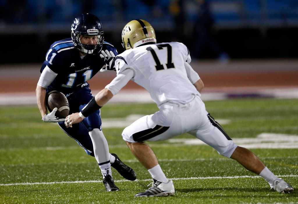 . Bellarmine College Prep\'s Henry Armistead (11) and Archbishop Mitty\'s Brian Bither (17) face off in the first half of their WCAL football game Friday night, Nov. 8, 2013 at San Jose City College in San Jose, Calif. (Karl Mondon/Bay Area News Group)