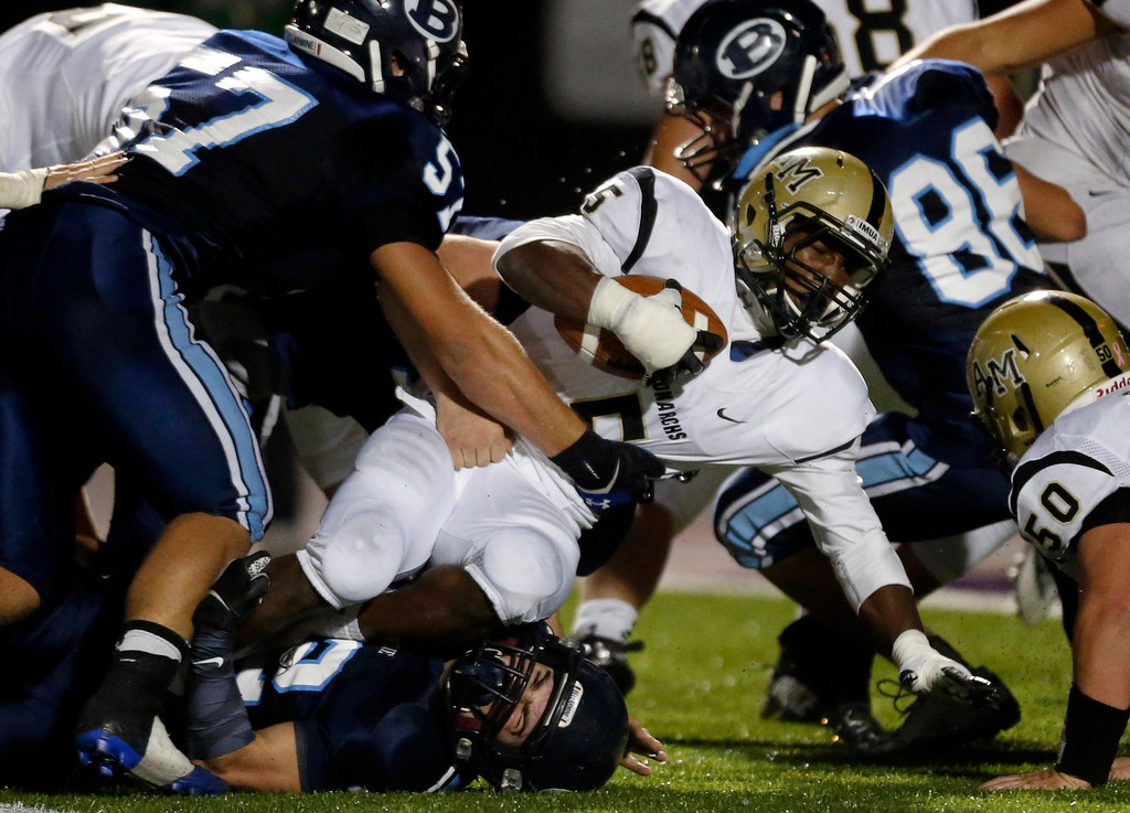 . Archbishop Mitty\'s Kyle Evans (5) rushes deep into Bellarmine College Prep territory in a WCAL football game Friday night, Nov. 8, 2013 at San Jose City College in San Jose, Calif. (Karl Mondon/Bay Area News Group)