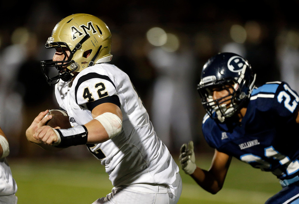 . Archbishop Mitty\'s Drew Mount (42) runs back an interception against Bellarmine College Prep in the fourth quarter of their WCAL football game Friday night, Nov. 8, 2013 at San Jose City College in San Jose, Calif. (Karl Mondon/Bay Area News Group)
