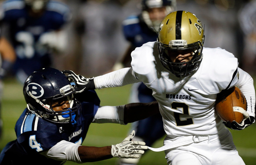 . Archbishop Mitty\'s Anthony Guttadauro (2) rushes against against Bellarmine College Prep\'s Grant Bush (4) in the fourth quarter of their WCAL football game Friday night, Nov. 8, 2013 at San Jose City College in San Jose, Calif. (Karl Mondon/Bay Area News Group)