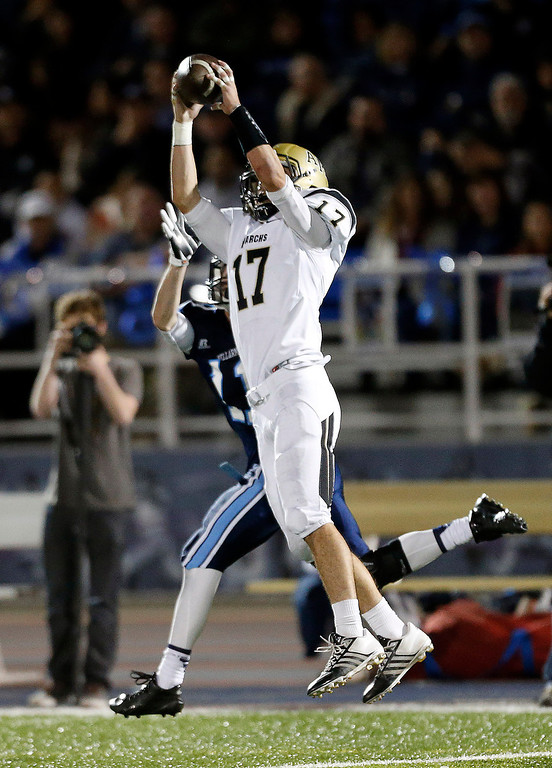 . Archbishop Mitty\'s Brian Bither (17) intercepts a pass against Bellarmine College Prep in the second quarter of their WCAL football game Friday night, Nov. 8, 2013 at San Jose City College in San Jose, Calif. (Karl Mondon/Bay Area News Group)