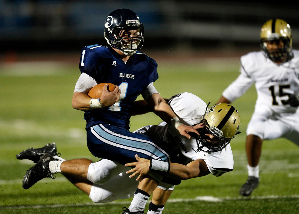 . Bellarmine College Prep\'s  Austin Changras (1) gets tackled by Archbishop Mitty\'s Paul Mack (75) on a second quarter kickoff return in a WCAL football game Friday night, Nov. 8, 2013 at San Jose City College in San Jose, Calif. (Karl Mondon/Bay Area News Group)