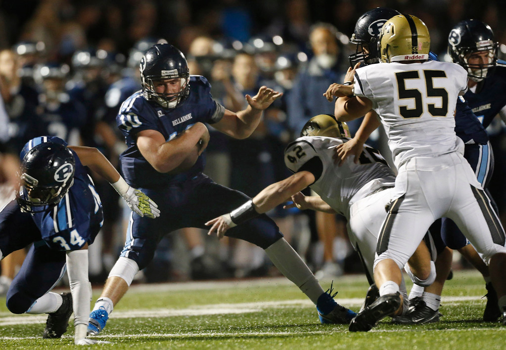. Bellarmine College Prep quarterback K.J. Carta-Samuels runs for a first down in the first quarter against Archbishop Mitty in a WCAL football game Friday night, Nov. 8, 2013 at San Jose City College in San Jose, Calif. (Karl Mondon/Bay Area News Group)