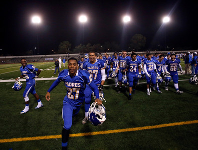 Serra runs off the field after their 28-17 victory over Bellarmine College Prep in a Central Coast Section Open Division semifinal football game at Independence High Friday night, Nov. 30, 2013, in San Jose, Calif. (Karl Mondon/Bay Area News Group)