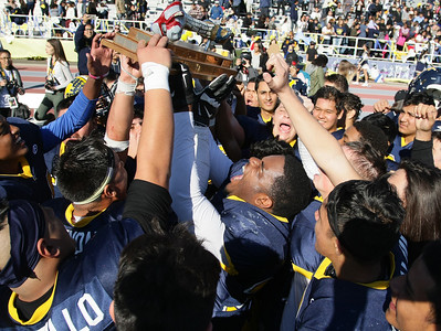 The victorious Lincoln High School football team celebrates after the 73rd annual Big Bone Game between San Jose High School and Lincoln High School played at San Jose City College on Thursday, Nov. 26, 2015 in San Jose, California. Lincoln defeated San Jose 7-0. (Photo by John Medina)
