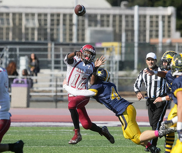 San Jose High quarterback Kylon Harris (#12) throws a pass while being pressured by Lincoln High's Matt Troxell (#41) during the 73rd annual Big Bone Game between San Jose High School and Lincoln High School played at San Jose City College on Thursday, Nov. 26, 2015 in San Jose, California. Lincoln defeated San Jose 7-0. (Photo by John Medina)