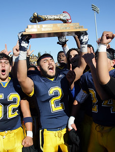 Lincoln High's Esteban Mosqueda (#2) hoists the Big Bone trophy after the 73rd annual Big Bone Game between San Jose High School and Lincoln High School played at San Jose City College on Thursday, Nov. 26, 2015 in San Jose, California. Lincoln defeated San Jose 7-0. (Photo by John Medina)
