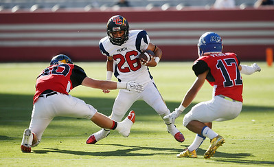 North's Manu Turituri is surrounded by the South's Jake Holton, at left, and Nicholas Perez in the first quarter during the Charlie Wedemeyer high school all-star football game at Levi's Stadium in Santa Clara, Calif., on Saturday, July 16, 2016. (Jim Gensheimer/Bay Area News Group)