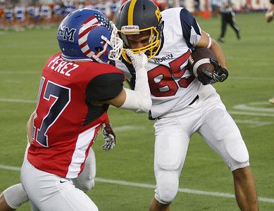 North's Paul Majchrowicz has his face mask pulled by South's Nicholas Perez in the fourth quarter during the Charlie Wedemeyer high school all-star football game at Levi's Stadium in Santa Clara, Calif., on Saturday, July 16, 2016. (Jim Gensheimer/Bay Area News Group)