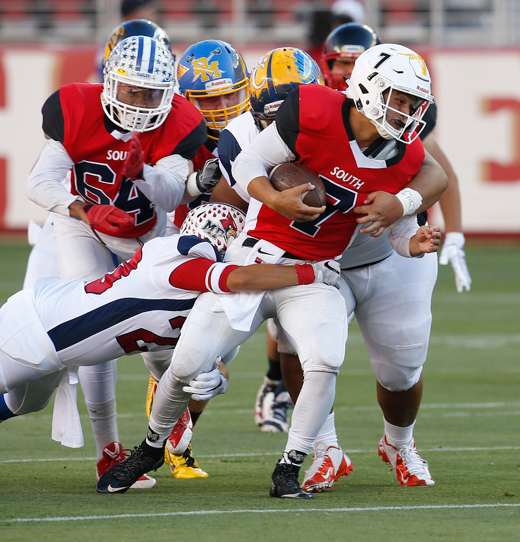 . South quarterback Sam Serra runs a keeper against the North in the first quarter during the Charlie Wedemeyer high school all-star football game at Levi\'s Stadium in Santa Clara, Calif., on Saturday, July 16, 2016. (Jim Gensheimer/Bay Area News Group)