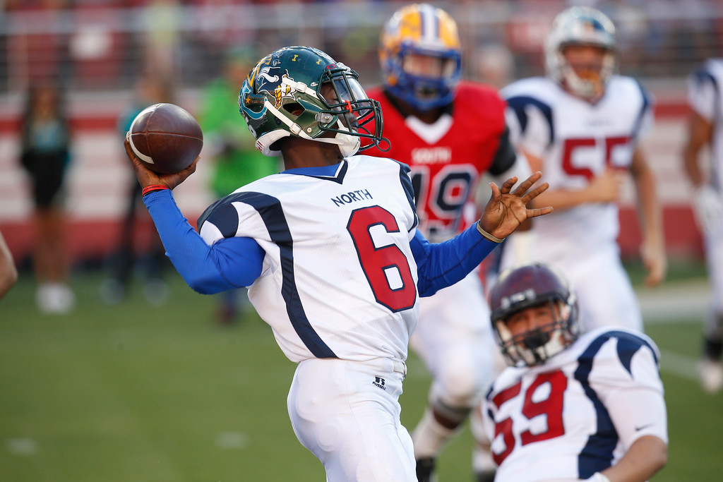 . North\'s Jerome Holloway passes the ball on a flea flicker play against the South in the second quarter during the Charlie Wedemeyer high school all-star football game at Levi\'s Stadium in Santa Clara, Calif., on Saturday, July 16, 2016. (Jim Gensheimer/Bay Area News Group)
