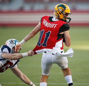 North's Tommy MacDevitt grabs the jersey of South quarterback Erik Ornduff in the third quarter during the Charlie Wedemeyer high school all-star football game at Levi's Stadium in Santa Clara, Calif., on Saturday, July 16, 2016. (Jim Gensheimer/Bay Area News Group)