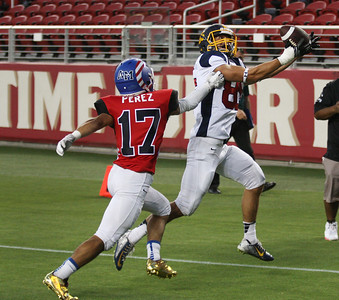 North's Paul Majchrowicz catches a pass in the end zone over South's Nicholas Perez in the fourth quarter during the Charlie Wedemeyer high school all-star football game at Levi's Stadium in Santa Clara, Calif., on Saturday, July 16, 2016. (Jim Gensheimer/Bay Area News Group)