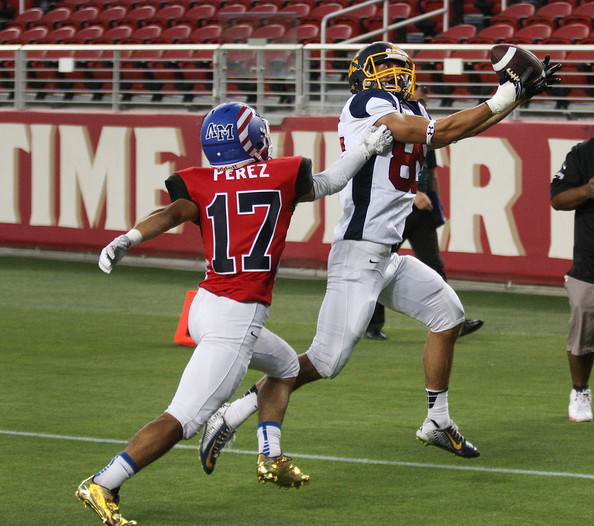 . North\'s Paul Majchrowicz catches a pass in the end zone over South\'s Nicholas Perez in the fourth quarter during the Charlie Wedemeyer high school all-star football game at Levi\'s Stadium in Santa Clara, Calif., on Saturday, July 16, 2016. (Jim Gensheimer/Bay Area News Group)