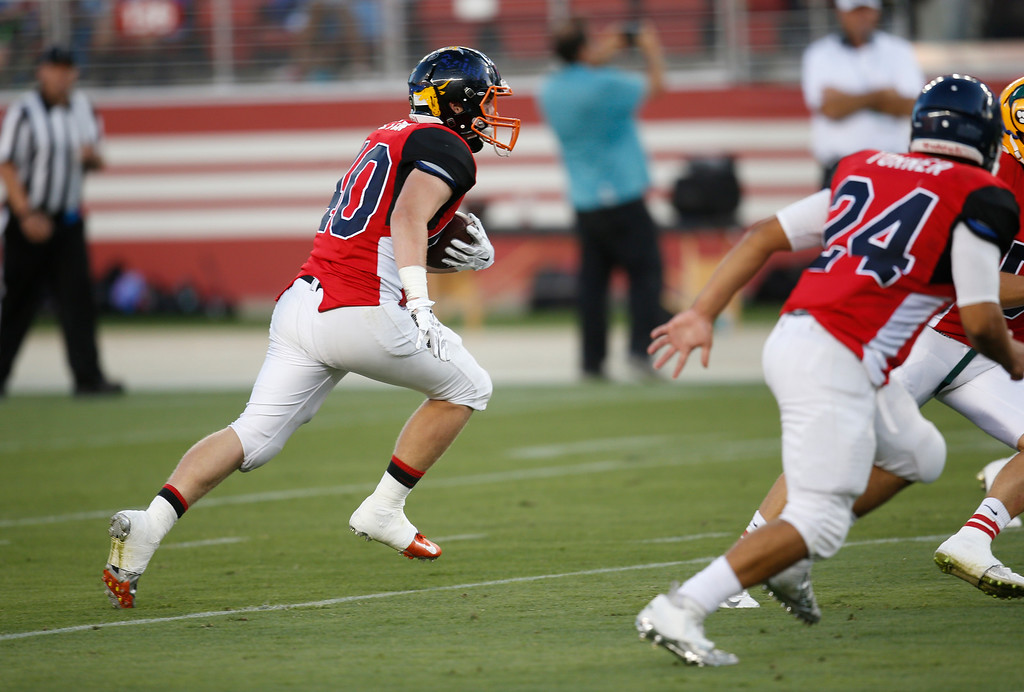 . South\'s Jake Holton runs back an interception against the North in the fourth quarter during the Charlie Wedemeyer high school all-star football game at Levi\'s Stadium in Santa Clara, Calif., on Saturday, July 16, 2016. (Jim Gensheimer/Bay Area News Group)