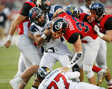 South's Colt Doughty pressures North quarterback Eduardo Andrade in the fourth quarter during the Charlie Wedemeyer high school all-star football game at Levi's Stadium in Santa Clara, Calif., on Saturday, July 16, 2016. (Jim Gensheimer/Bay Area News Group)