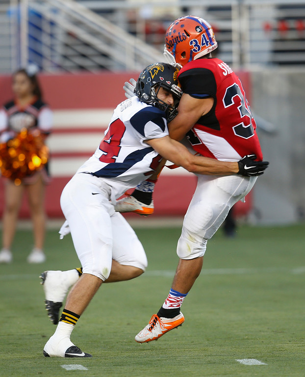 . South kicker Troy Sanchez is roughed up on a punt by North\'s Danny Holton in the third quarter during the Charlie Wedemeyer high school all-star football game at Levi\'s Stadium in Santa Clara, Calif., on Saturday, July 16, 2016. (Jim Gensheimer/Bay Area News Group)