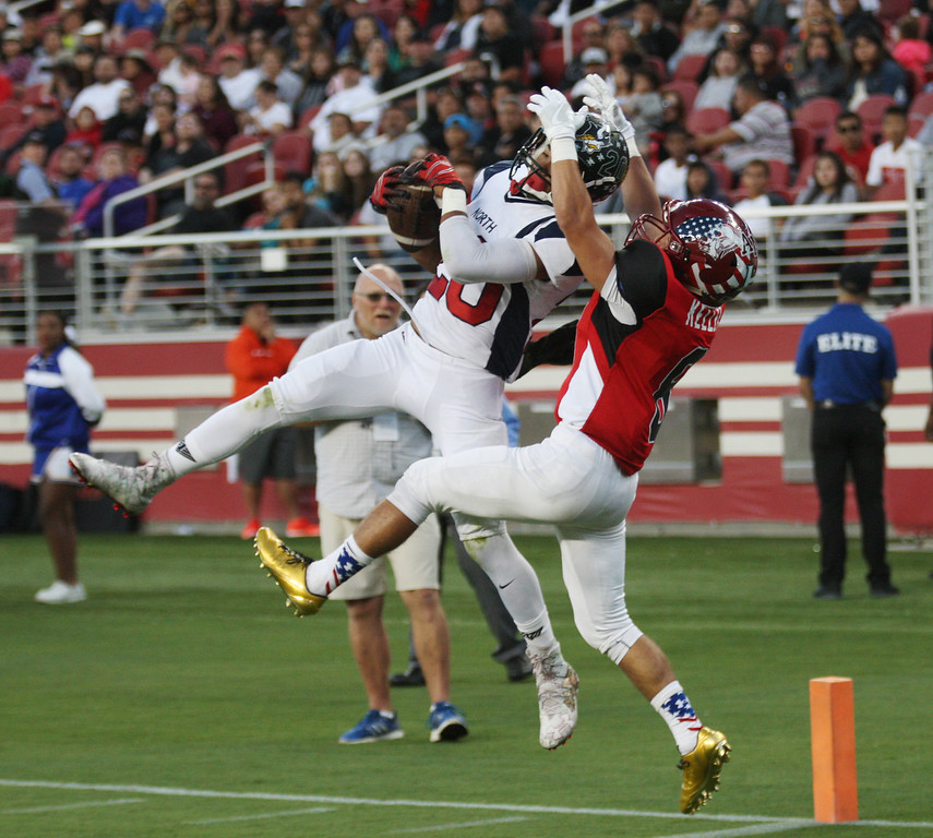. North\'s Damen Evans intercepts a pass intended for  South\'s Johnathan Keller in the fourth quarter during the Charlie Wedemeyer high school all-star football game at Levi\'s Stadium in Santa Clara, Calif., on Saturday, July 16, 2016. (Jim Gensheimer/Bay Area News Group)